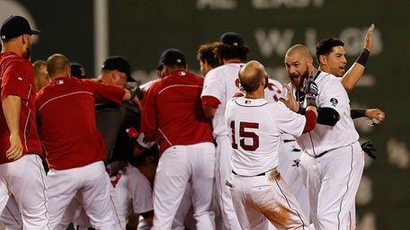 Boston Red Sox teammates Dustin Pedroia (#15) and