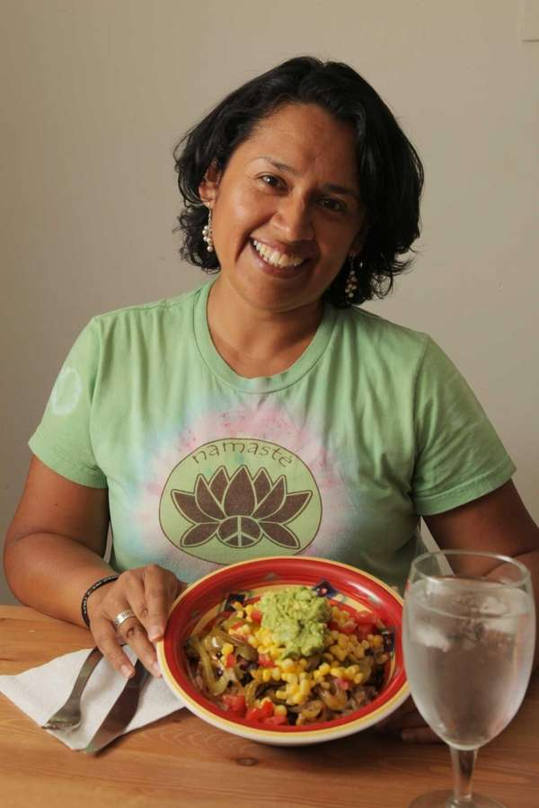 Rosanna Jimenez shows her rice-and-beans burrito bowl at