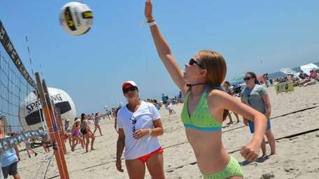 Three-time Olympic gold medalist Misty May-Treanor watched as