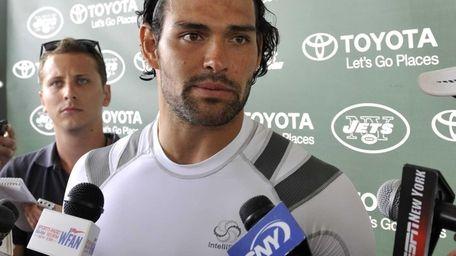 Jets quarterback Mark Sanchez talks with reporters during