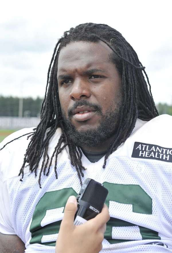 Jets guard Willie Colon talks with reporters during