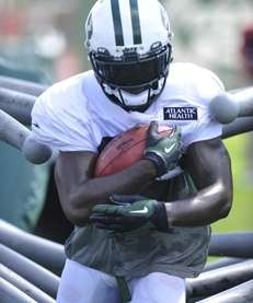 Jets running back Joe McKnight runs the guantlet