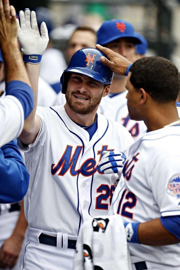 Teammates congratulate Mets second baseman Daniel Murphy (28)