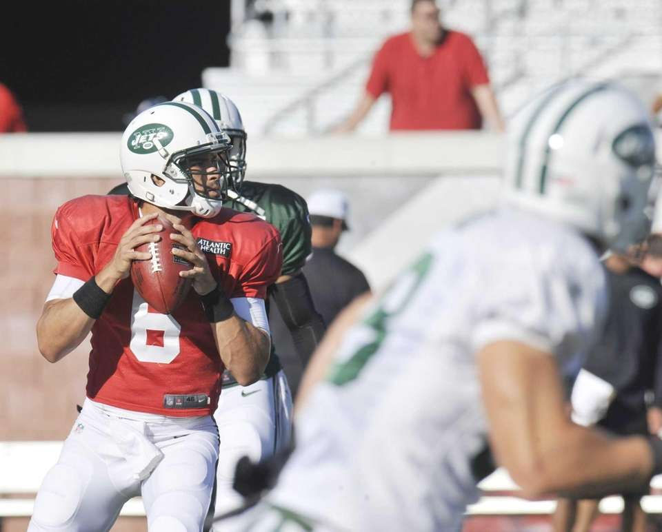 Jets quarterback Mark Sanchez drops back during training