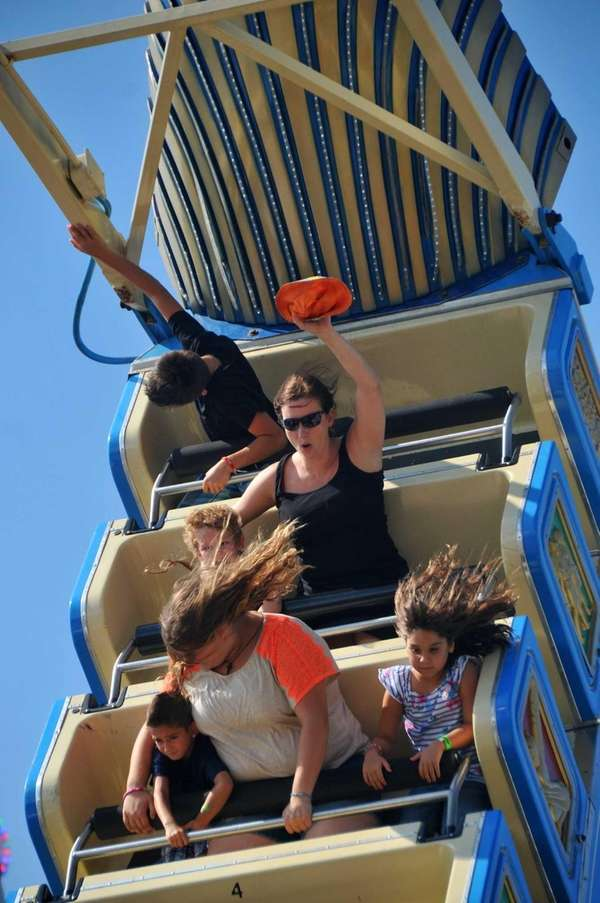 Festival-goers enjoy the rides at the Feast of