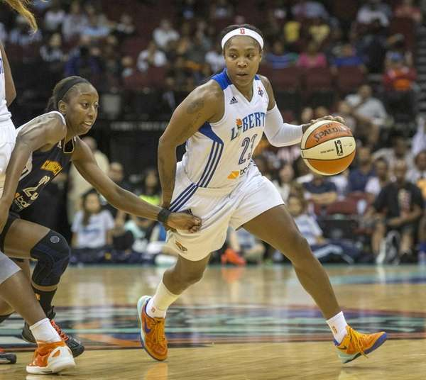 Liberty guard Cappie Pondexter, right, gets around a