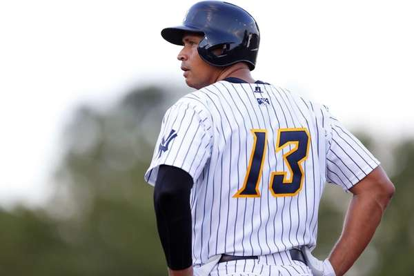 Alex Rodriguez stands on first base after drawing