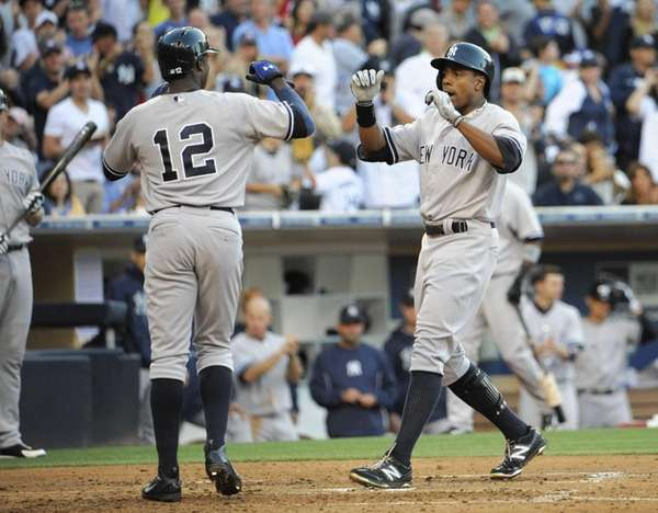 Curtis Granderson of the Yankees, right, is congratulated