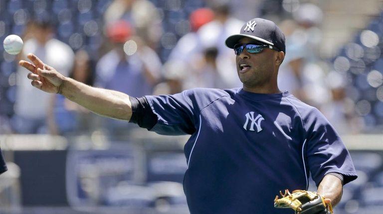 Yankees second baseman Robinson Cano gets loose during