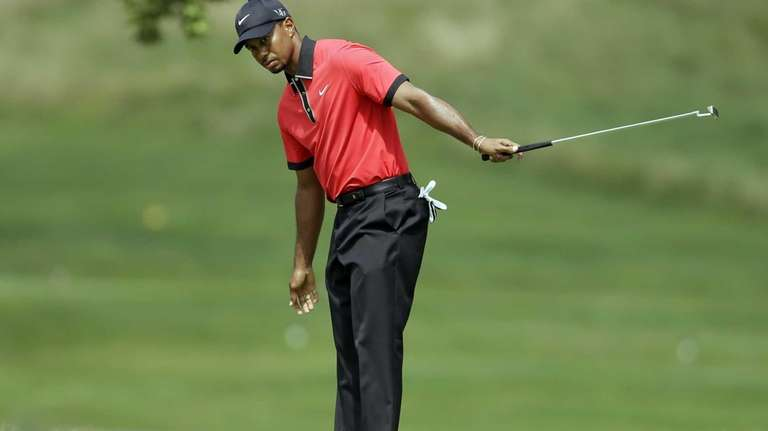 Tiger Woods reacts after missing a birdie putt