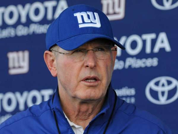 Tom Coughlin speaks to the media after a