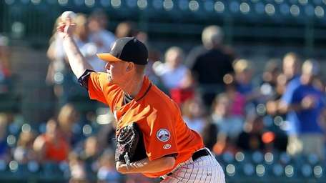 Ducks starting pitcher Pete Budkevics delivers in a