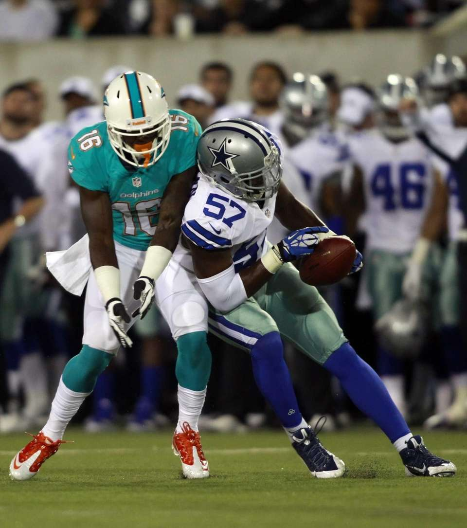 Dallas Cowboys outside linebacker DeVonte Holloman (57) intercepts
