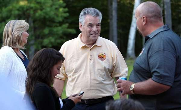 U.S. Rep. Pete King, R-N.Y., center, talks with