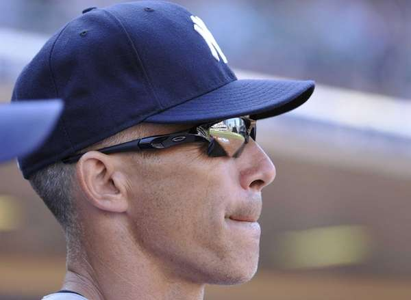 Joe Girardi looks on during the ninth inning