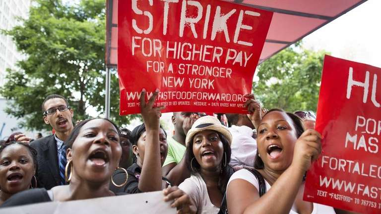 Demonstrators in support of fast food workers protest