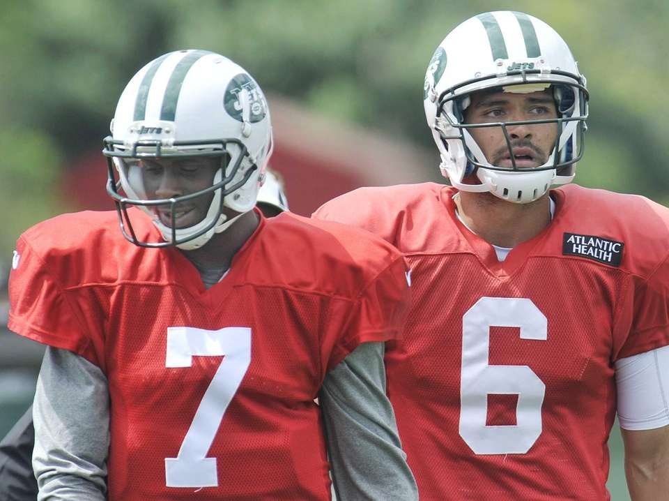 Jets quarterbacks Geno Smith, left, and Mark Sanchez