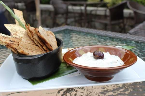 Labneh or hummus comes with flatbread at the