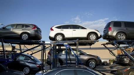 Higher second-quarter SUV and pickup truck sales helped