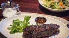 The NY Strip Steak is tender and juicy
