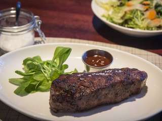 The NY Strip Steak is tender and juicy