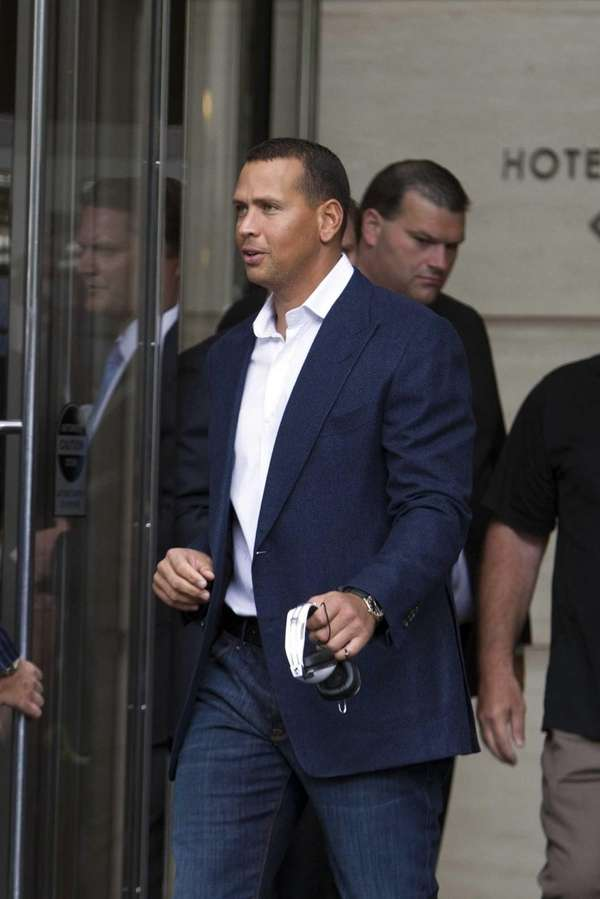 Alex Rodriguez leaves the Trump International Hotel in