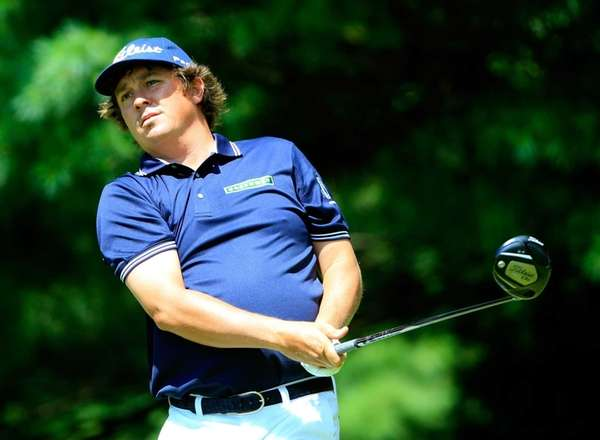 Jason Dufner hits off the second tee during