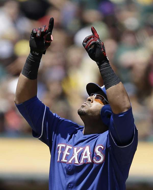 Texas Rangers outfielder Nelson Cruz celebrates after hitting