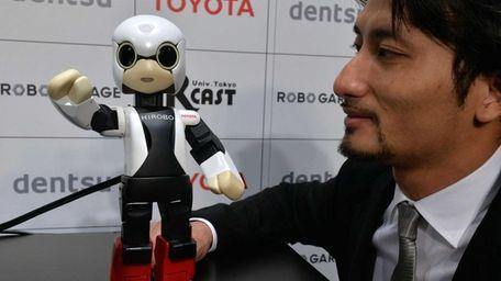 A small humanoid robot Kirobo and Japan's Tokyo