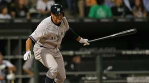 Alex Rodriguez reacts after flying out in the