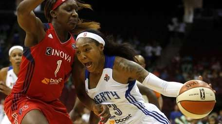 Liberty guard Cappie Pondexter, right, drives against the
