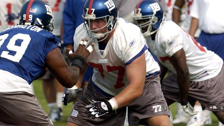 Luke Petitgout blocks a defender during Giants training