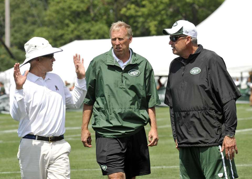 Jets owner Woody Johnson, left, talks with general