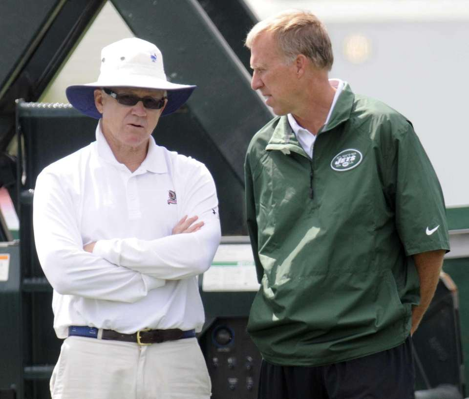 Jets owner Woody Johnson, left, and general manager