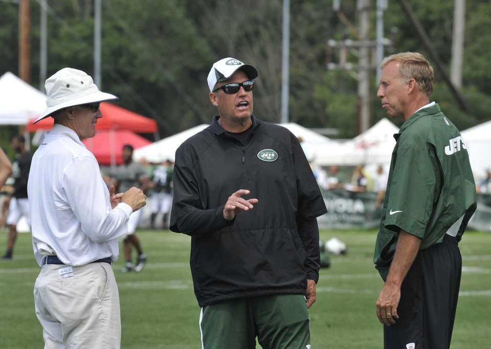 Jets owner Woody Johnson, left, talks with head