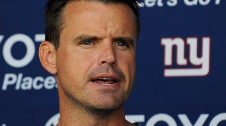 Giants coach Sean Ryan speaks to the media