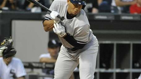 Alex Rodriguez reacts after getting hit by a