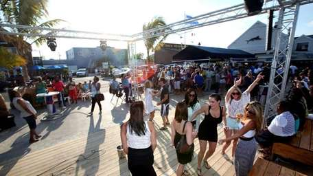 Patrons dance at Bracco's on the Nautical Mile