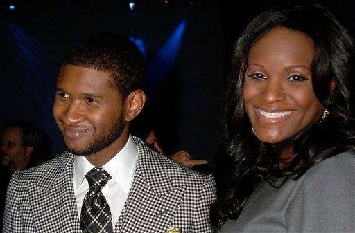 Usher Raymond and then-wife Tameka Foster at a
