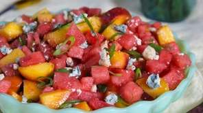 Watermelon, peaches, scallions and blue cheese splashed with