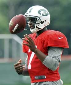 Geno Smith looks on during training camp in