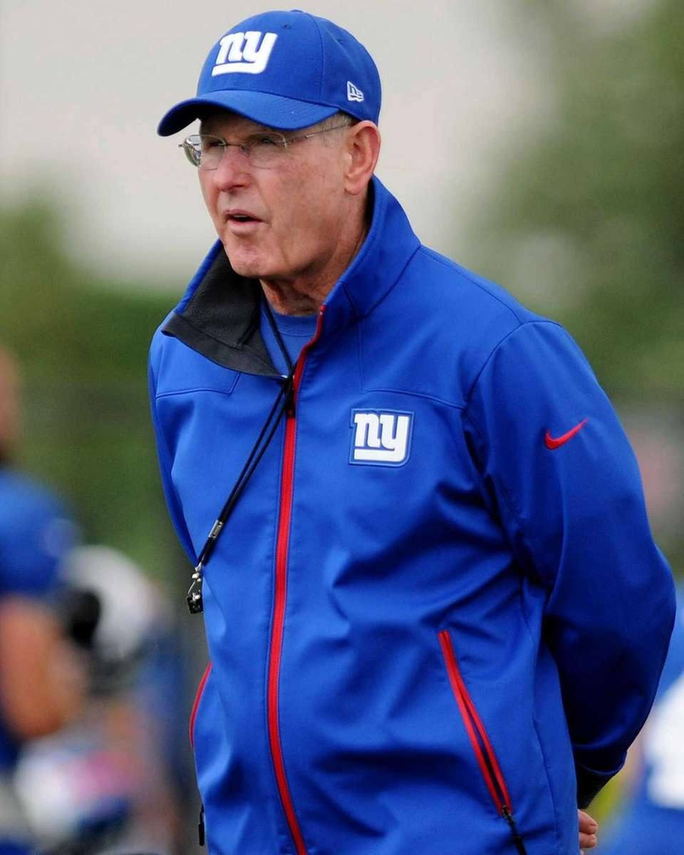Giants head coach Tom Coughlin surveys the field