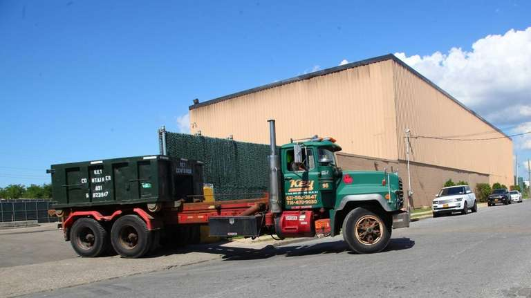 Trucks at One World Recycling in Lindenhurst. (Aug