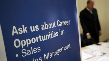 A recruiter waits to meet with job seekers