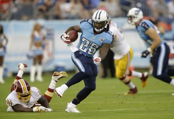 Tennessee Titans running back Chris Johnson, center, gets