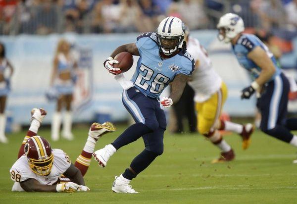 Tennessee Titans running back Chris Johnson, center, gets
