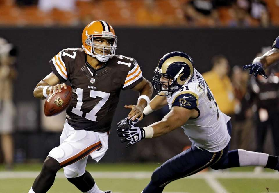 Cleveland Browns quarterback Jason Campbell (#17) is chased