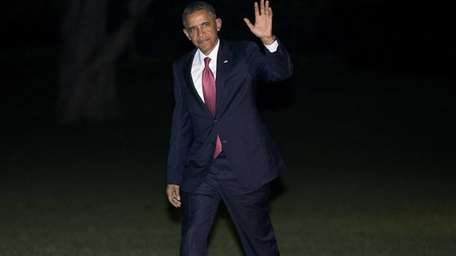 President Barack Obama waves following his arrival on