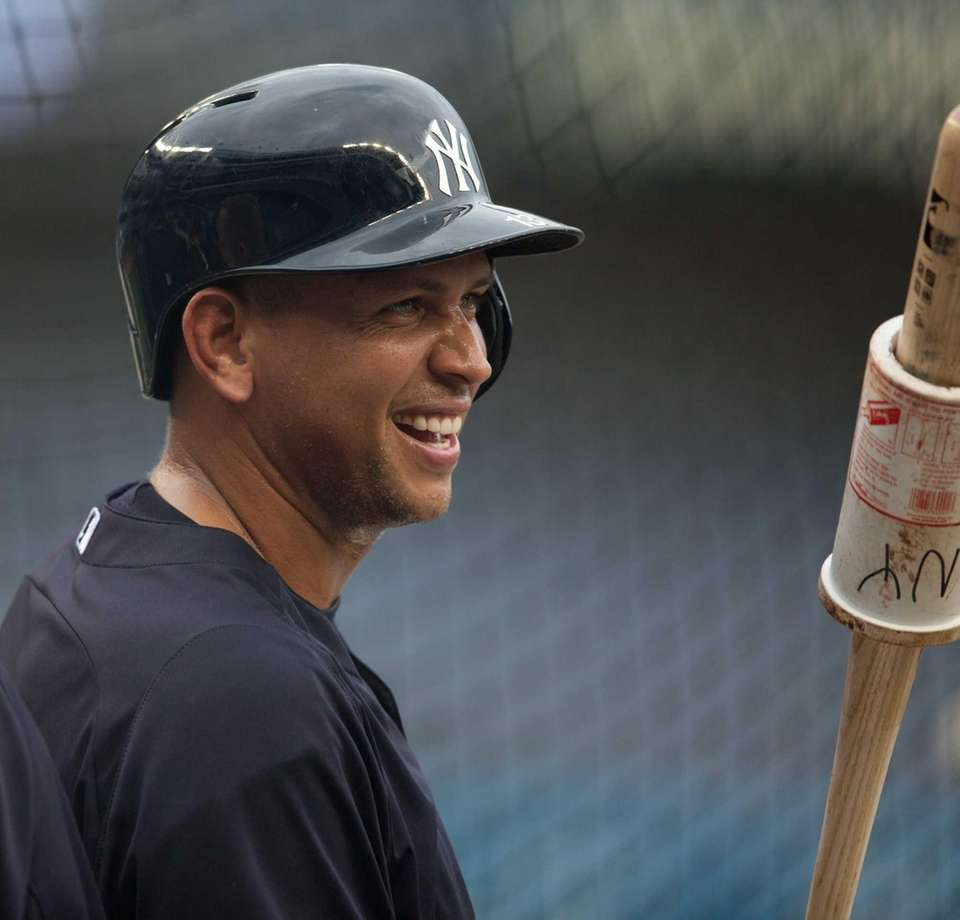 Alex Rodriguez of the Yankees warms up during