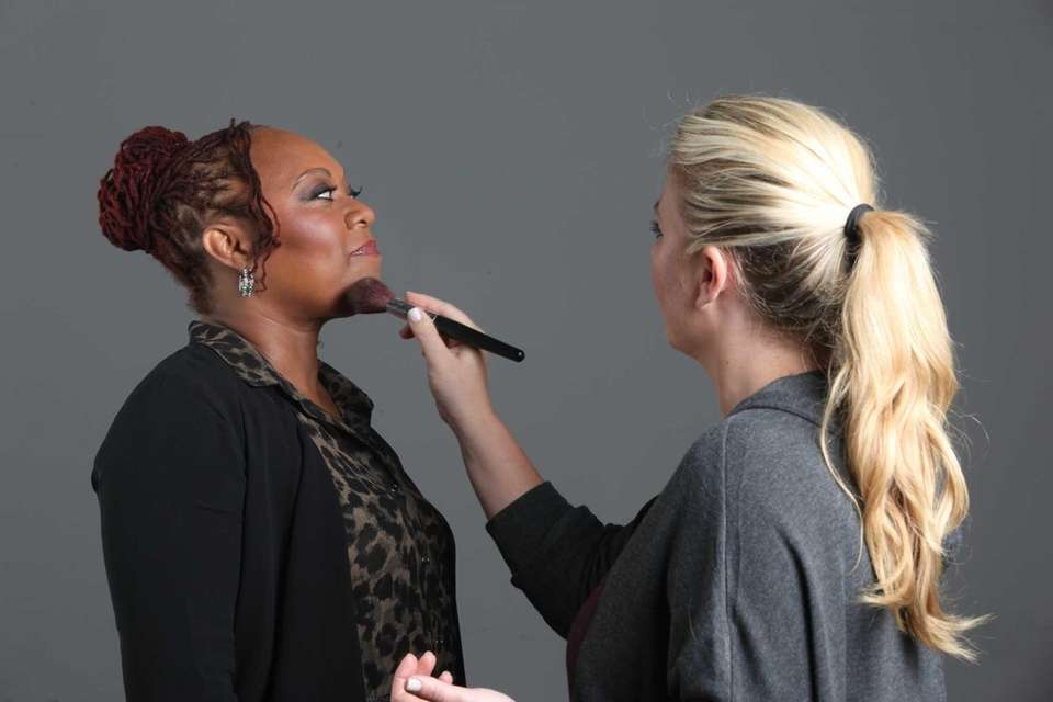 Carol Copper has her makeup done for her
